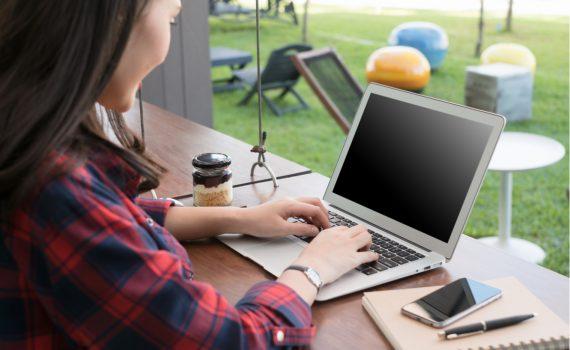 Woman using wireless networking