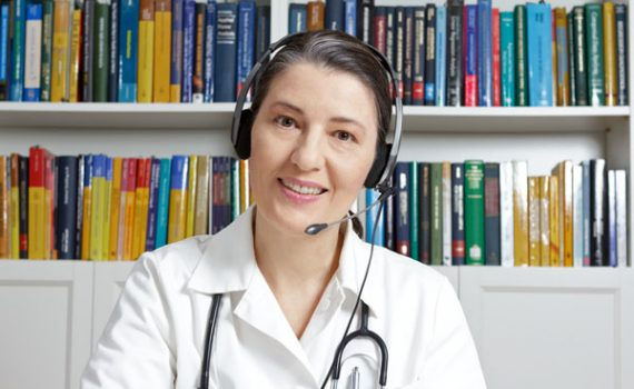 Doctor using VoiP service with patient